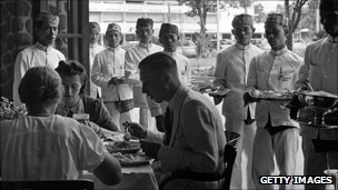 circa 1940: Dutch colonialists eating in Java