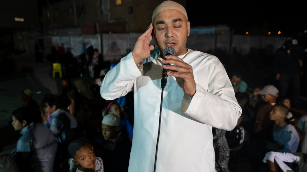 A man calling Muslims to prayer in Manenberg, Cape Town - South Africa