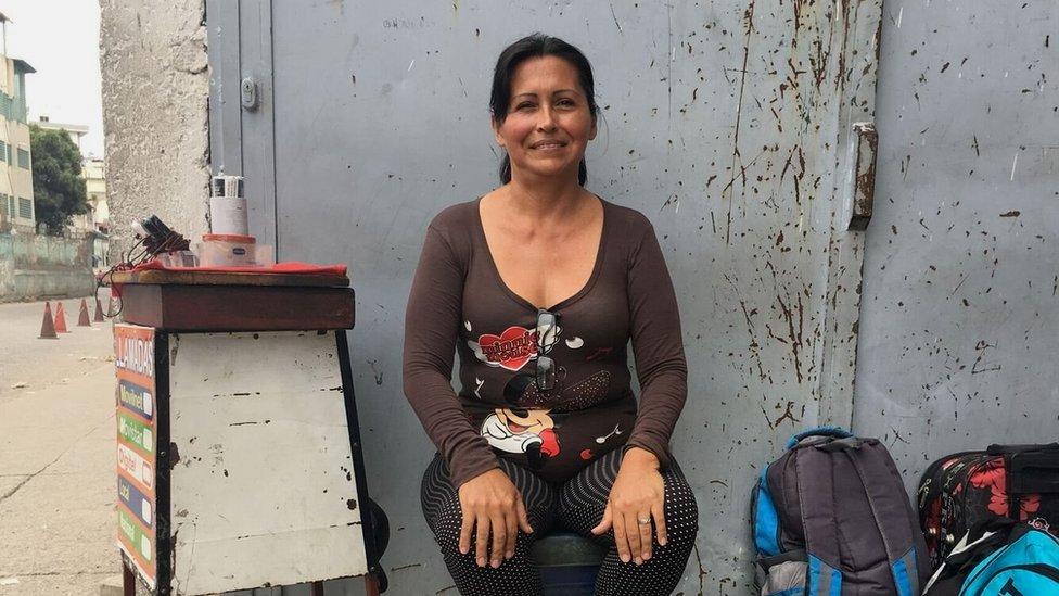 María Becerra runs a little stall next to the bus station