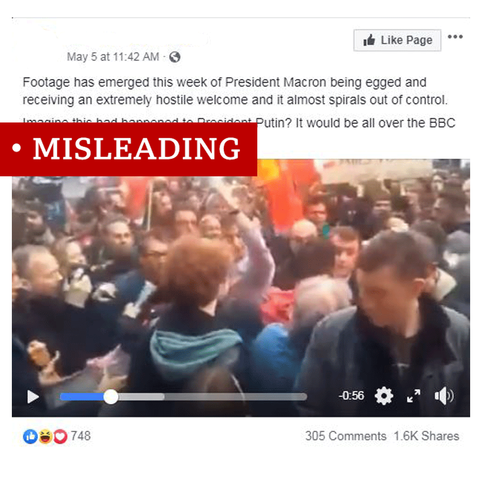 "Screenshot of video showing Emmanuel Macron getting egged. Video labelled ""misleading"""