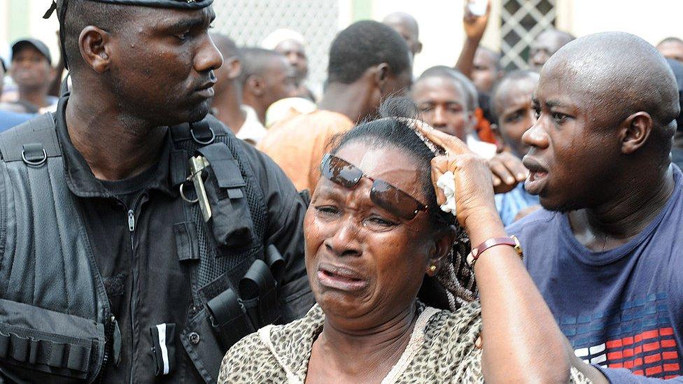 A woman in tear in Conakry following the stadium massacre in 2009, Guinea
