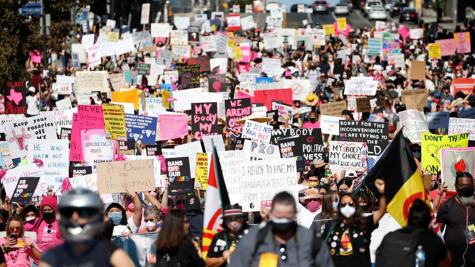 Protesters take part in the Women's March and Rally for Abortion Justice in Los Angeles on 2 October 2021