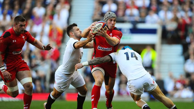 Jonathan Davies of Wales is tackled by Danny Care and Jack Nowell of England in the Six Nations match between England and Wales at Twickenham in 2014.