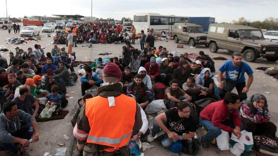 Migrants wait for buses in Nickelsdorf, Austria