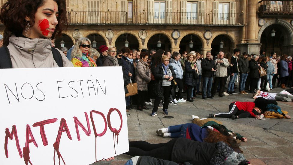"""A demonstrator holds a banner reading """"They are killing us"""", as several Fine Arts College students stage a rally in memory of murdered Spanish teacher Laura Luelmo, in Salamanca, northern Spain, 19 December 2018"""