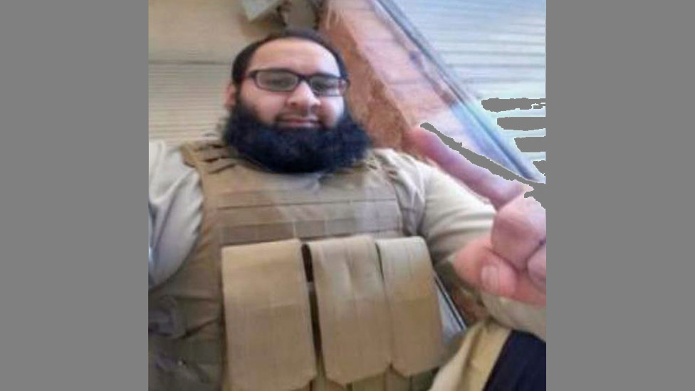 Naweed Hussain, wearing what looks like an explosives belt