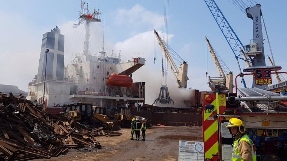 Crews tackle fire on board cargo ship in Southampton