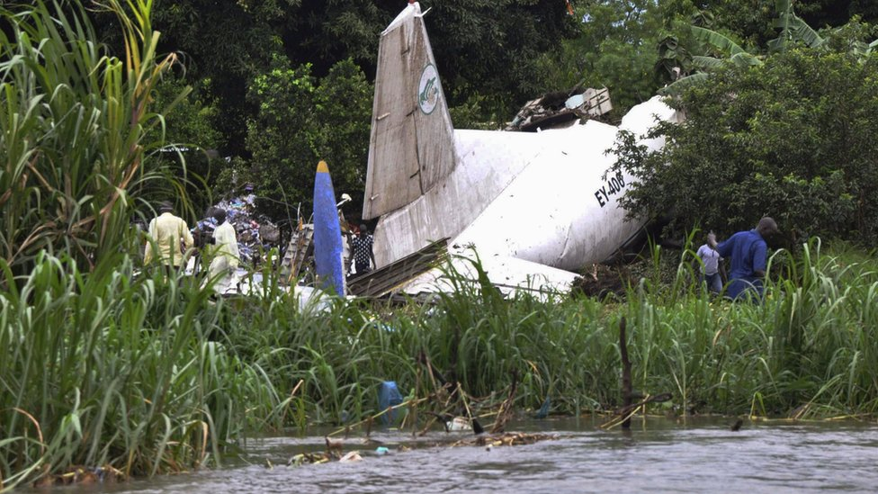 Officials investigate the wreckage of a cargo airplane
