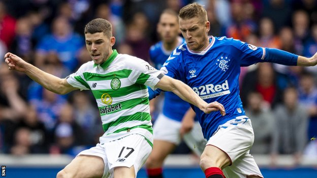 Celtic's Ryan Christie (left) holds off Rangers' Steven Davis during an Old Firm match last season