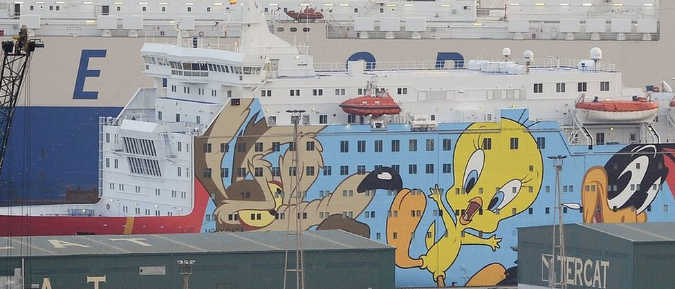 """A ship, decorated with """"Looney Toons"""" characters is moored in Barcelona to house police reinforcements on September 21, 2017"""