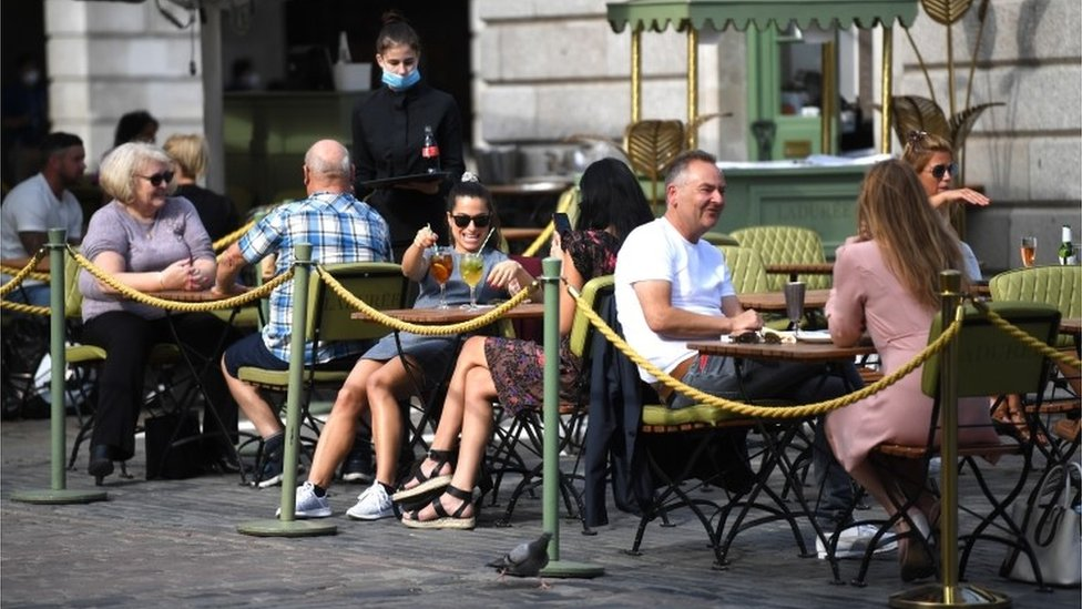 People eat in a restaurant in Covent Garden, London