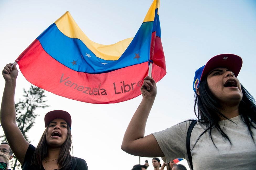 "Venezuelan citizens living in Chile shout slogans during a demonstration against president Nicolas Maduro""s government in Santiago, Chile, on April 30, 2019"