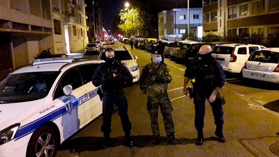 Police secure a street after a Greek Orthodox priest was shot and injured at a church in the centre of Lyon, France, 31 October, 2020