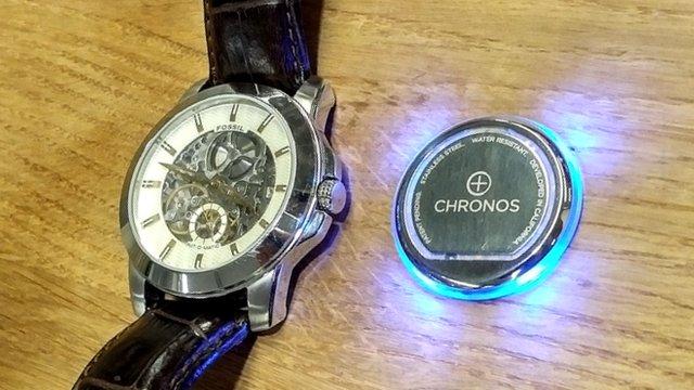 Chronos pad next to a watch