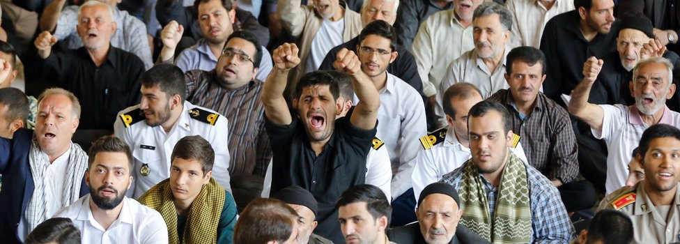 Iranian worshippers shout anti-US slogans during the weekly Friday prayer in Tehran on 13 October 2017