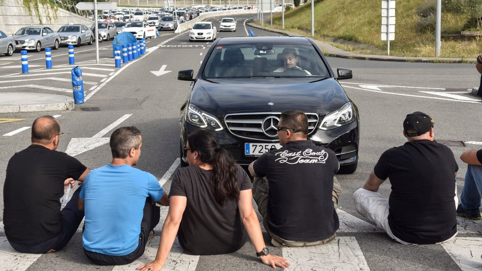 Taxi drivers block the access to airport in Bilbao, Basque Country, northern 30 July 2018.
