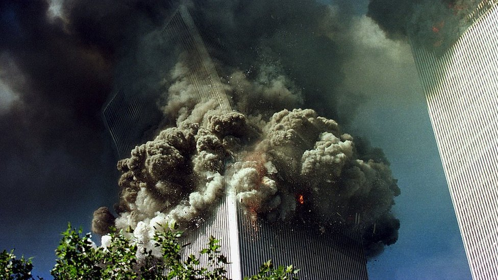 The south tower of the World Trade Center collapses September 11, 2001 in New York City.