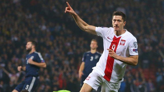 Poland striker Robert Lewandowski scores against Scotland in the Euro 2016 qualifiers