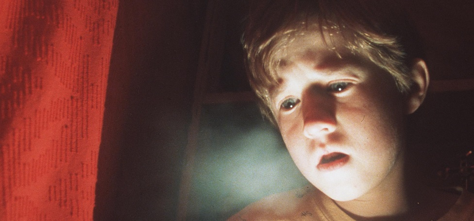 "Frightened By His Paranormal Powers, 8-Year-Old Cole Sear (Haley Joel Osment) Is Too Young To Understand His Purpose In ""The Sixth Sense."""