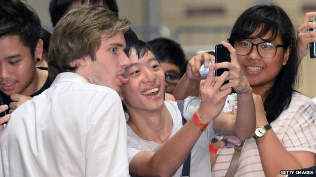 Felix Kjellberg poses for pictures with fans