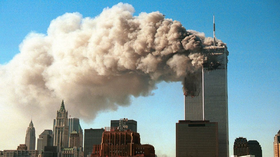 Smoke pours from the twin towers of the World Trade Center after they were hit by two hijacked airliners in a terrorist attack September 11, 2001 in New York City.