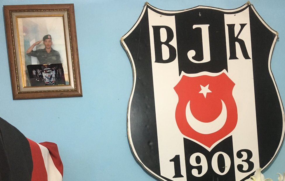 Bedroom wall with football club shield