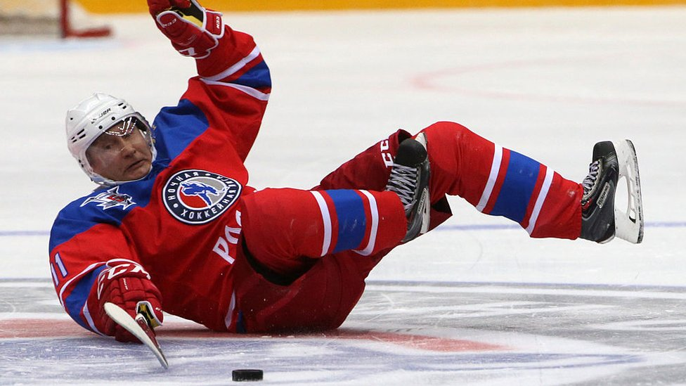 Vladimir Putin slipping while playing ice hockey