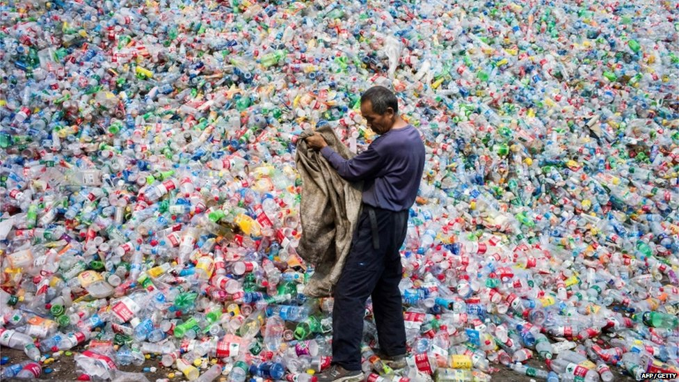 Chinese labourer sorting out plastic bottles for recycling in Dong Xiao Kou village, on the outskirt of Beijing