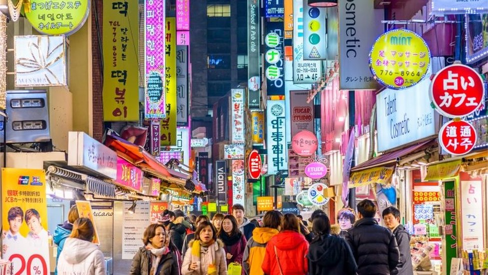 Crowds enjoy the Myeong-Dong district at night. The district is known as one of the main shopping and tourism areas.<br />Keywords Korea, Seoul, Korean Culture, Korean Ethnicity, South Korea, Street, Nightlife, Sign, Crowd, Myeong-dong, Downtown, Fashion, Night, People, Restaurant, Shop, 2015