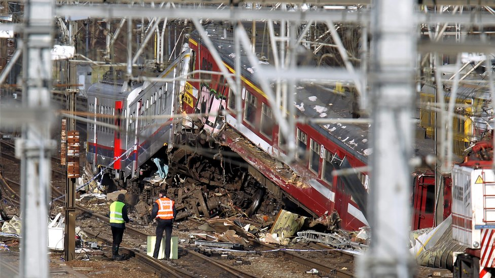 Technicians assess the wrecks of the trains that collided near the Buizingen train station in Halle, 21 February 2010