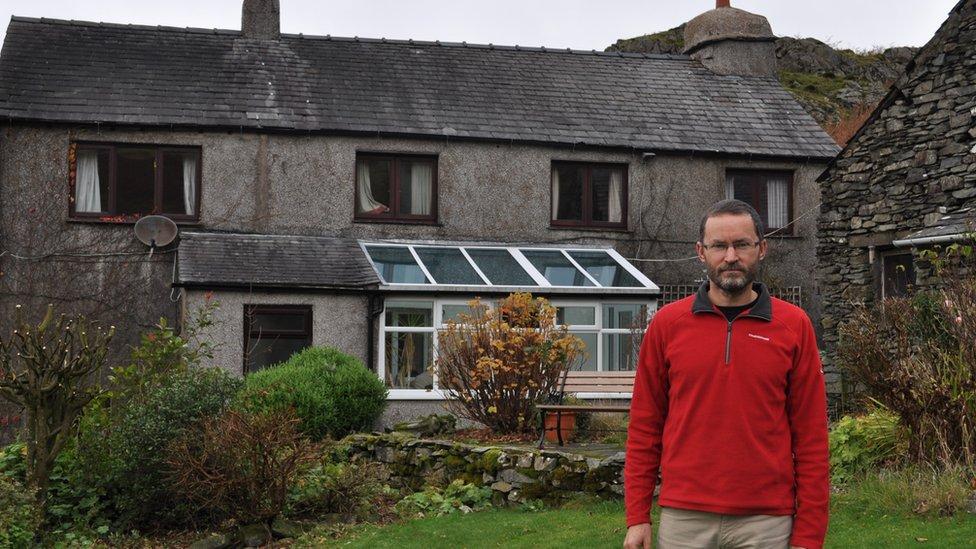 Mike Hooper outside his house