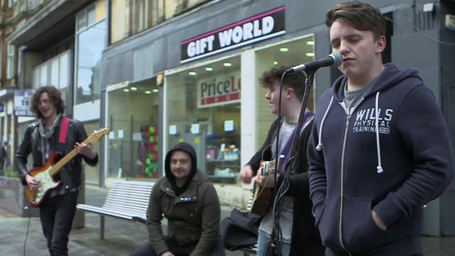 Musicians performing in Paisley High Street