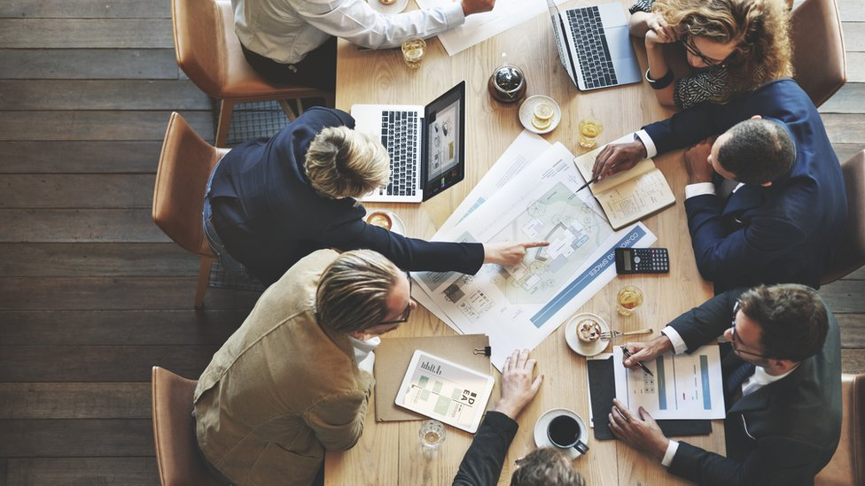 Overhead shot of office workers at a table