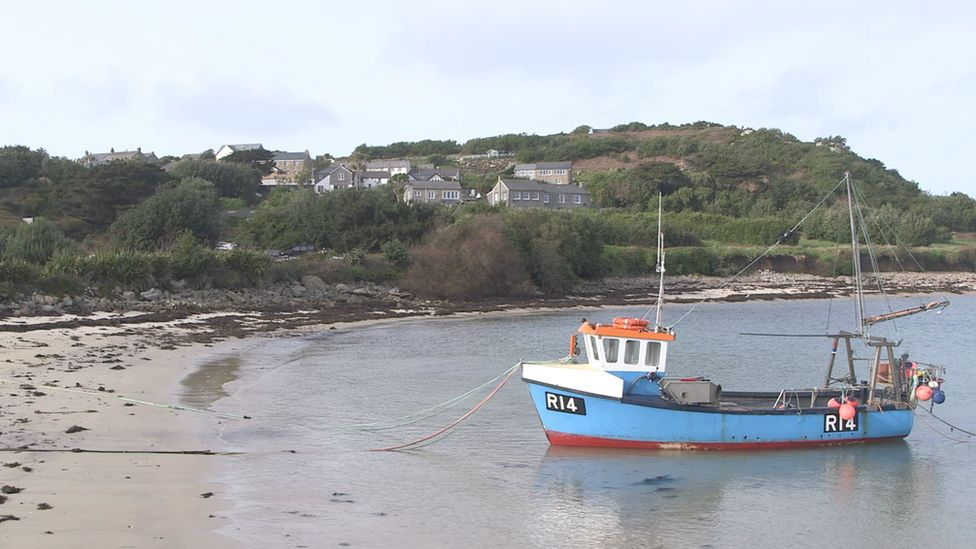 Fishing boat lies off coast
