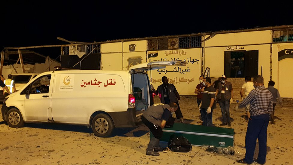 Emergency workers arrive to the scene were an airstrike killed nearly 40 at Tajoura Detention Center, east of Tripoli