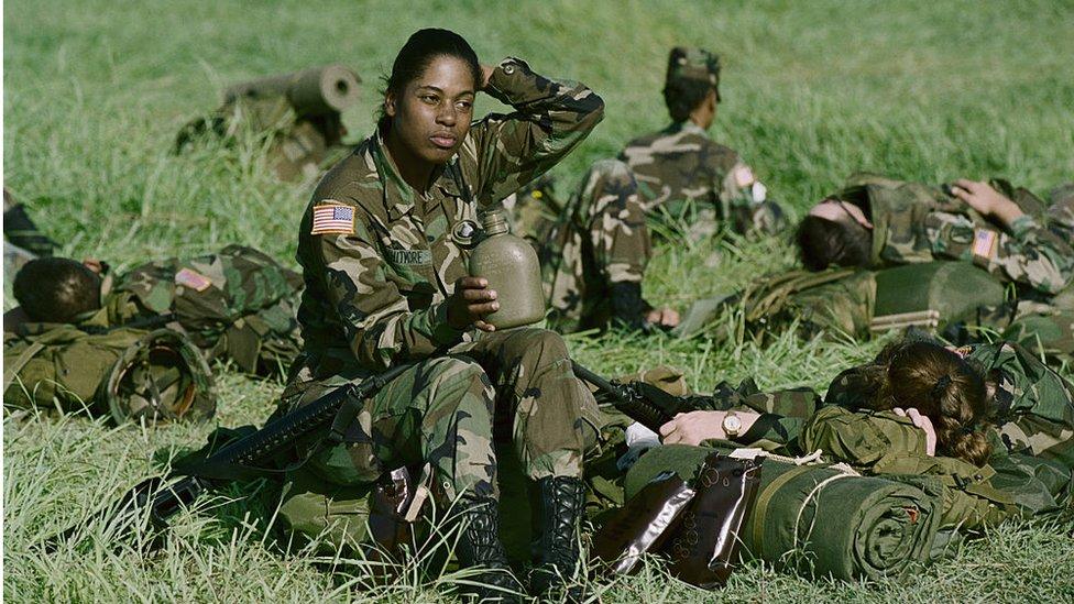 Female soldier in field 1994