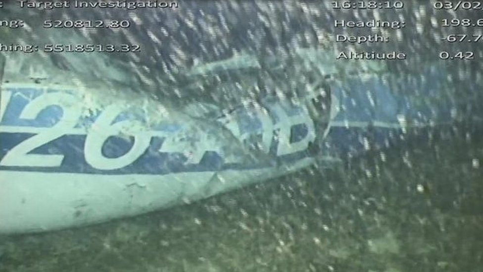 Air accident investigators' photo showing the rear left side of the fuselage