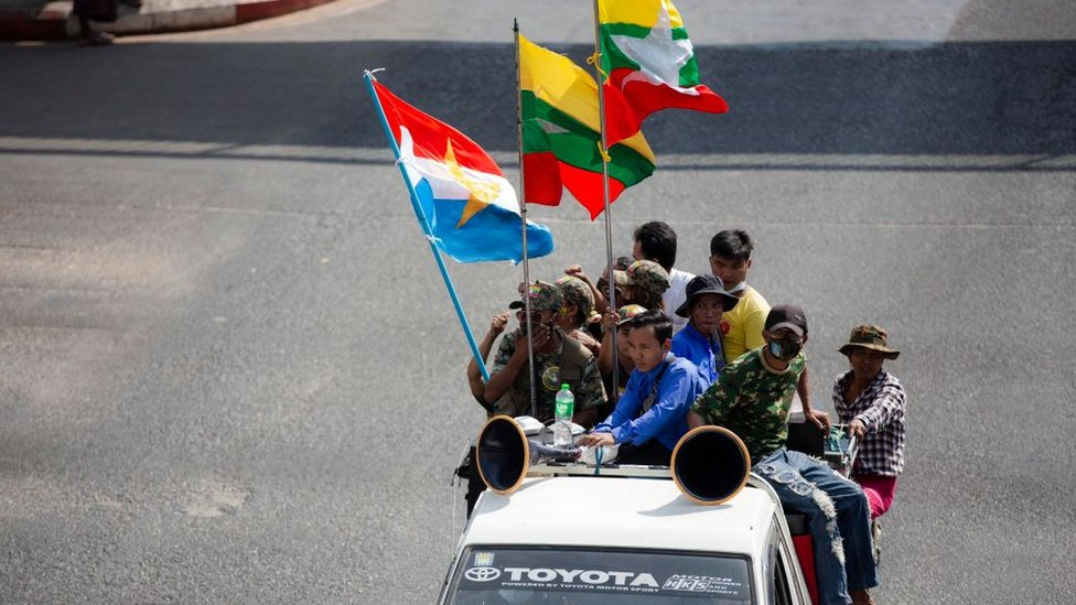 Military supporters drive along the Streets in Yangon.