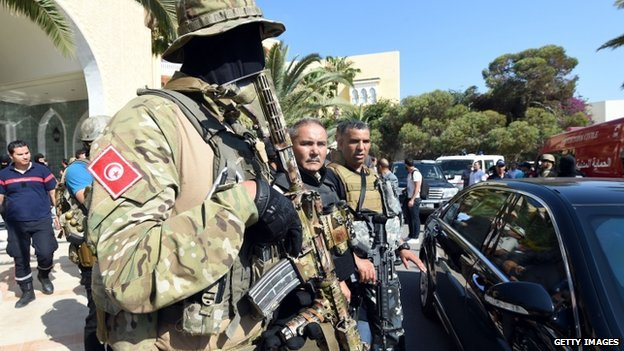 Tunisia security forces stand in front of the hotel following the attack