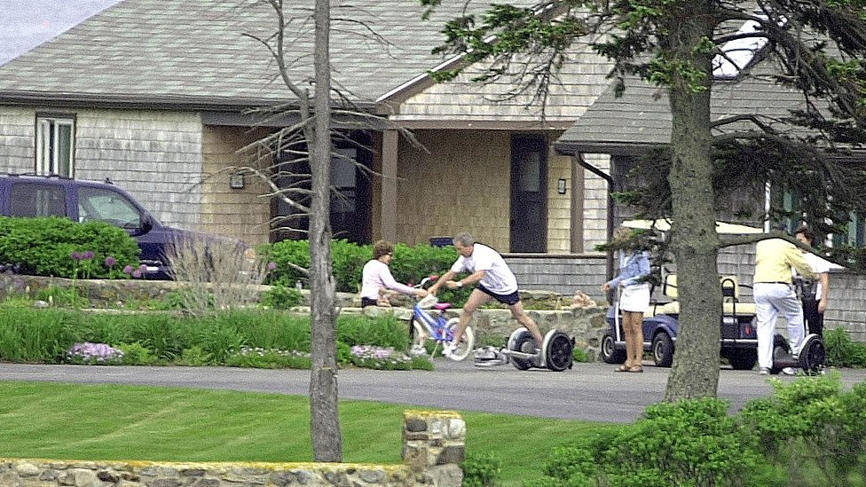 George W. Bush falls off a Segway Scooter at his parent's home.