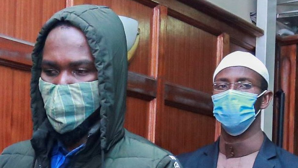 Hussein Hassann Mustafah (L) and Mohamed Ahmed Andayi (R) leave the dock after they were found guilty of aiding gunmen in the Westgate Mall attack at a Milimani court, Nairobi, Kenya, 07 October 2020.