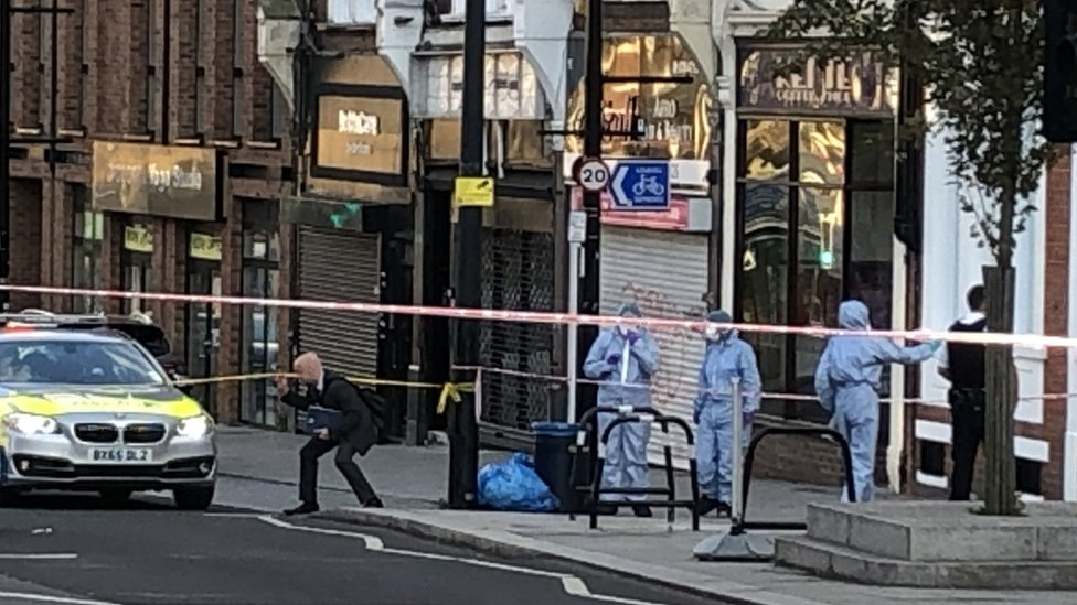 A police crime scene in Sydenham Road, south-east London, after a man in his twenties was found with gunshot wounds and died at the scene on Sunday afternoon