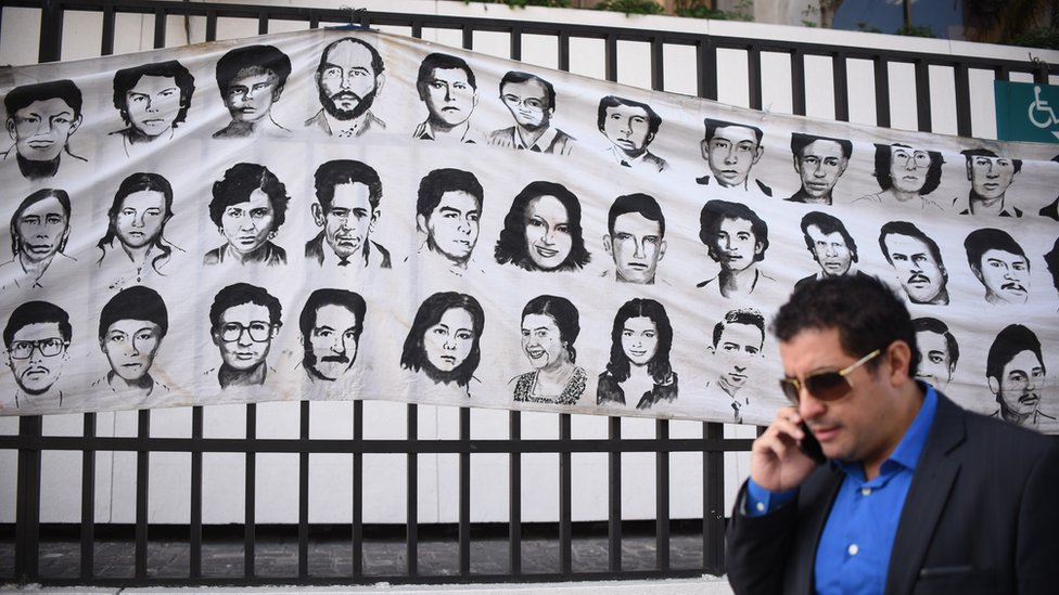 Banner with portraits of disappeared Guatemalans