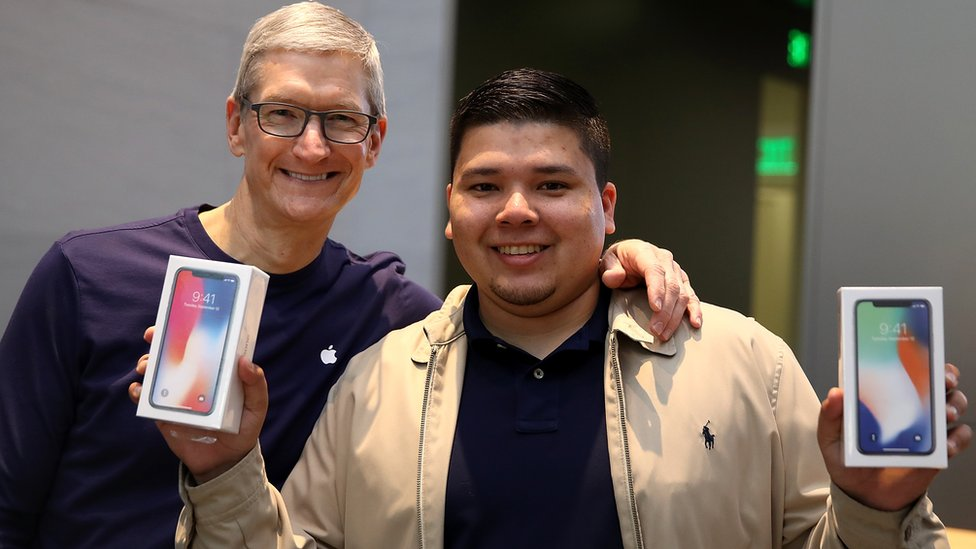 Apple chief executive Tim Cook and iPhone X buyer David Casarez in Palo Alto last November