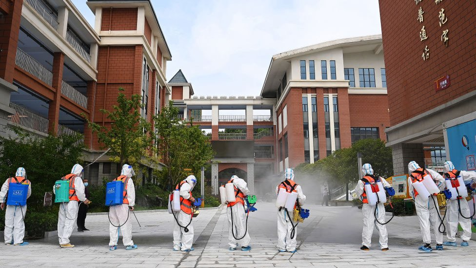 Workers disinfect primary school in Wuhan on 25 August 2021. Photo Barcroft Media