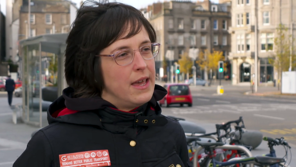 Ellie Harrison, chair of the Get Glasgow Moving campaign, being interviewed beside a road