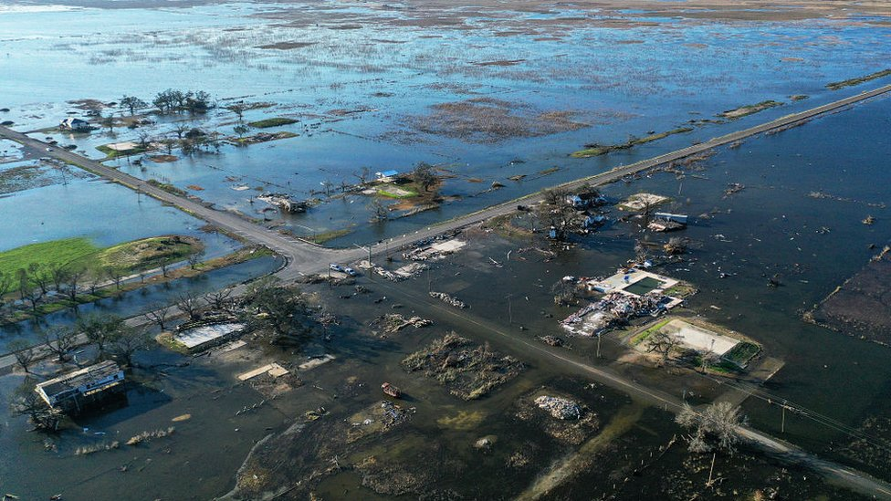 Flood waters from Hurricane Delta surrounding buildings which had been destroyed by August's Hurricane Laura. October 10, 2020 in Creole, Louisiana