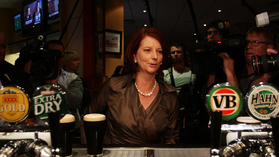 Julia Gillard at the bar in a pub on the campaign trail in 2010