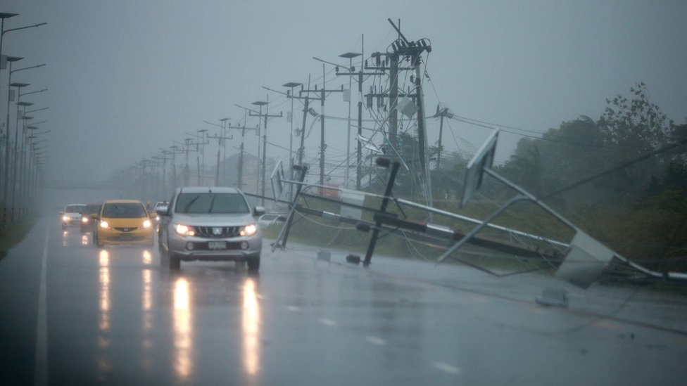 Power lines on road with cars