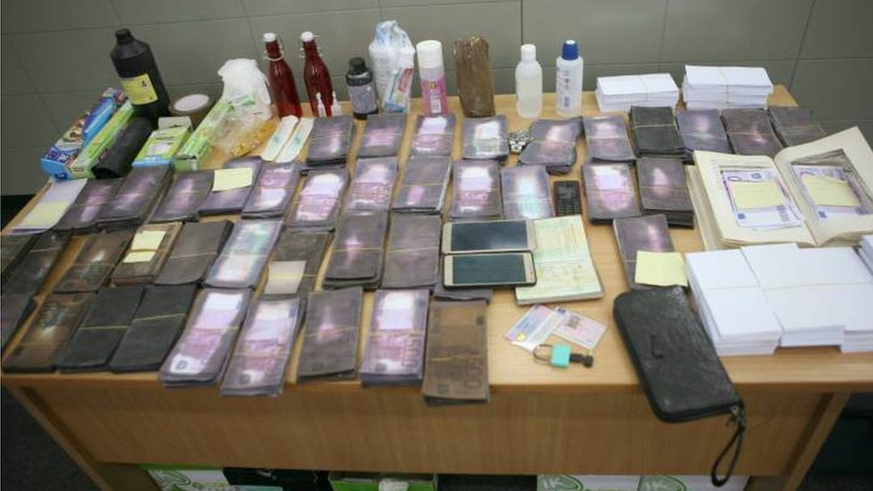 The evidence seized by police is arranged on a table at a press event held by the authorities